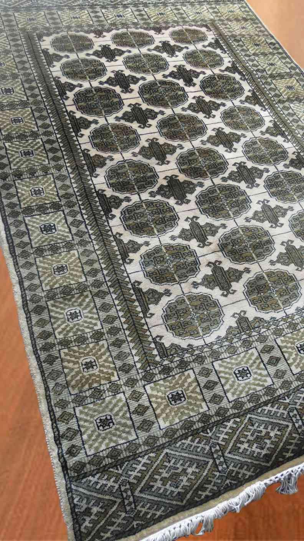 Cream And Green Handmade Woolen Carpet