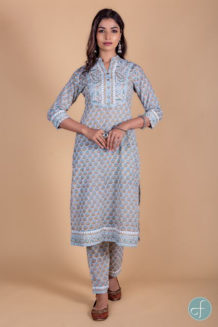 A-Line kurta dipped in light color base with floral peach and yellow block print is a perfect choice for the summer season. This 3/4th sleeves kurta set is embellished with sequins buttons  throughout the length Gota detailing can be seen on the neck,slee